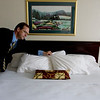 "Record-Eagle/ Keith King<br /> General manager Michael Hall shows off one of the refurbished guest rooms at the Traverse City Days Inn & Suites along munson Avenue that recently completed around $1 million in renovations. Upgrades included new carpet, wall treatments, furniture and bed linens, flat-screen TVs, new appliances and lighting and laundry improvements. ""It's a more classic look that contributes to our image as a traditional hotel,"" Hall said."