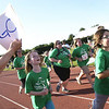 Record-Eagle/Garret Leiva<br /> Supporters encourage Girls on the Run participants as they near the finish line of a 5K run at the Traverse City Central High School track. Girls on the Run is a nationwide program that combines training for a 3.1-mile run over a 12-week program along with guidance to make healthy lifestyle choices.