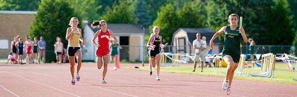 Record-Eagle/Jan-Michael Stump<br /> Anchor runner Lilia Favela of Traverse City West finishes ahead of the pack in the 800 meter relay at Tuesday's Record-Eagle Honor Roll Meet at Traverse City Central.