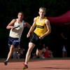 Record-Eagle/Jan-Michael Stump<br /> Anchor runners Jack Stevens of Traverse City Central (first place, right) and Traverse City St. Francis' Ben Swan (second, left) round the final curve in the 800 meter relay in the Record-Eagle Honor Roll Meet.