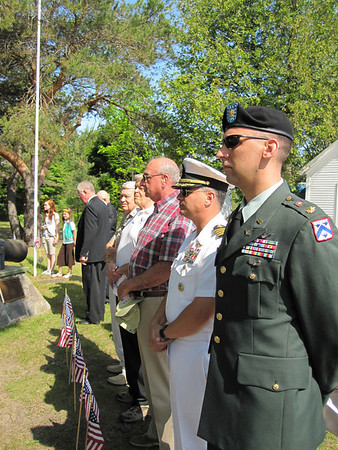 Record-Eagle/Loraine Anderson<br /> Veterans representing American wars stand at attention as Northport's Memorial Day ceremonies begin Monday morning at Leelanau Township Cemetery. Veterans from right are: Maj. Aaron Kohler (Iraqi Freedom), Capt. John Stamos (Persian Gulf), James Custer (Vietnam),  Dick Hanson (Korean War) and Raymond Ross (World War II). Three empty chairs draped in black ribbon, not pictured, honored the veterans of World War I, the Spanish-American War and the Civil War.