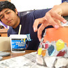 Record-Eagle/Sarah Brower<br /> Jorge Alvarado, 16, decorates a flower pot in a class called Sunrise Crafters, hoping to sell it. Students learn basic business skills through the class.