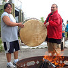 Record-Eagle/Sarah Brower<br /> Dave Anderson and Shocko Hall warm up the drum before they perform at the grand opening of the new Eyaawing Museum and Cultural Center.