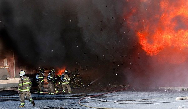 Record-Eagle/Douglas Tesner<br /> Firefighters from several local fire departments battled a major fire at Wholesale Rustic Furniture on U.S. 31 South Wednesday afternoon. No injuries were reported.