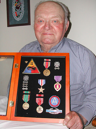 Record-Eagle/Sheri McWhirter<br /> World War II veteran Wendell Holmes received a number of medals and awards during his time in the U.S. Army for his efforts in major battles, such as the D-Day invasion at Normandy and the Battle of the Bulge.