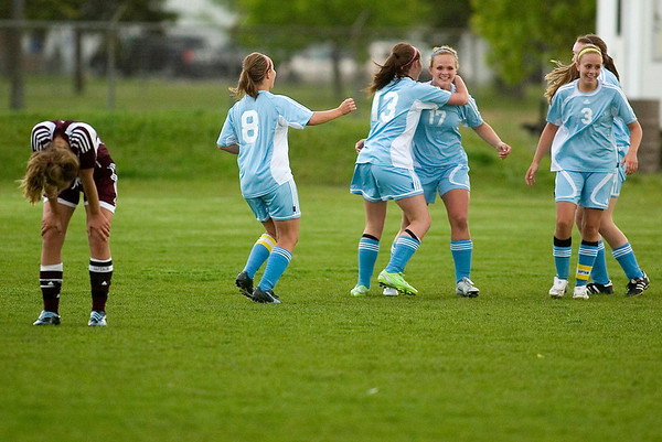 Record-Eagle/Jan-Michael Stump<br /> Liberty players celebrate Danielle Heger's (17) goal during Tuesday's regional win.