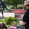"Record-Eagle/Douglas Tesner<br /> Alan Maciag, an artist from Bridgeport, works on his impression of Clinch Park Beach and the statue ""Time To Let Go,"" by Verna Bartnick. The painter, a retired art teacher, is spending several days in the area."