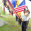 Record-Eagle/Sarah Brower<br /> The colorguard, led by Jack Swanson holding the Odawa Nation eagle staff, arrives at the grand opening celebration of the new Eyaawing Museum and Cultural Center in Peshawbestown. The Grand Traverse Band of Ottawa and Chippewa Indians opened the $1.65 million facility Saturday. The 8,500-square-foot building has two stories and was designed to reflect the sovereign nation's culture.