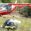 Record-Eagle/Sarah Brower<br /> A man walked away after crashing his kit plane on a small hill near the Sand Lakes Quiet Area.