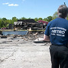 Record-Eagle/Douglas Tesner <br /> Grand Traverse Metro fire investigator Mike Lince looks at the remains of Wholesale Rustic Furniture in Garfield Township.