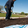 Record-Eagle/Douglas Tesner<br /> John Fraiser, an employee of the Traverse City Parks and Recreation Department, prepares the flower bed for its annual planting in the Open Space by the Friendly Garden Club Traverse City. The bed will feature a cherry cluster.