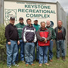 Record-Eagle/Sarah Brower<br /> From left, Steve Taylor, Jim Furstenberg, Tyler Champt, Reg Rix, Remy Champt, Darrell Rogers and Jeff Ross, stand in front of the Keystone Recreational Complex sign.