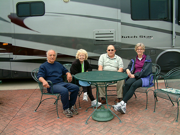 Record-Eagle/Marta Hepler Drahos<br /> Ray Russell, Maggie Russell, Dennis Sheridan and Kirsten Hermansen gather at the Russells' Traverse Bay RV Resort home.