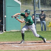 Record-Eagle/Keith King<br /> Traverse City West's Trent Mcdougall bunts the ball against Traverse City Central Thursday, May 10, 2012 at Traverse City West High School.