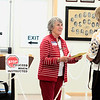 Record-Eagle/Jan-Michael Stump<br /> Joan Richardson, right, hands her ballot to Whitewater Township election worker Mary Anne Rivers-Friese on Tuesday afternoon.