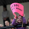 Record-Eagle/Jan-Michael Stump<br /> Olivia Strange, 7, of Ellsworth waves a sign for her father, Mike Strange, who graduated from Ferris State University with highest honors in information security and intelligence  as part of Saturday's Northwestern Michigan College commencement ceremony.