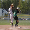 Record-Eagle/Keith King<br /> Traverse City Central's Mikhaila Shepler catches the ball at first base as Traverse City West's Michelle Ravellette runs by Thursday, May 10, 2012 at Traverse City West High School. Ravellette was called safe on the play.