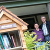 Record-Eagle/Jan-Michael Stump<br /> Homer Nye and Becky Mang will be stewards for Traverse City's first Little Free Library - only the second in Michigan - outside their home on Spruce Street at Sixth Street in the Kids Creek Neighborhood. The library offers passers-by the opportunity to take book and leave one for future visitors.