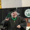 Record-Eagle/Jan-Michael Stump<br /> Curtis Hill waves his diploma during Saturday's Northwestern Michigan College Commencement ceremony.