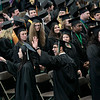 Record-Eagle/Jan-Michael Stump<br /> Northwestern Michigan College students walk into the Traverse City Central High School gym to start Saturday's commencement ceremony.