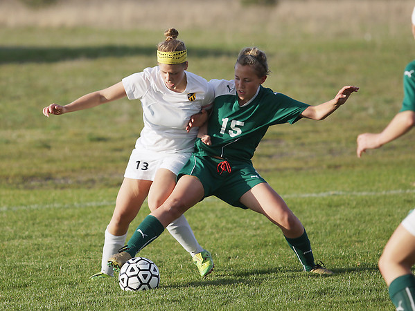 Record-Eagle/Keith King<br /> Traverse City Central's Cari Rice (13) and Traverse City West's Eva Brunetti (15) battle for the ball Tuesday at the Coast Guard fields in Traverse City.