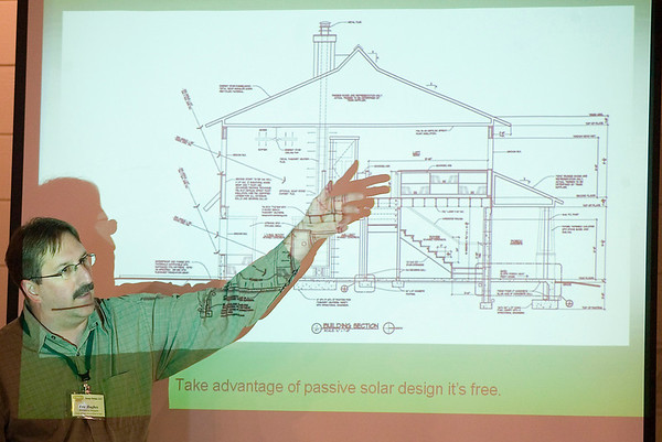 Record-Eagle/Jan-Michael Stump<br /> Architect Eric Hughes discusses a home he built in Kingsley with builder Joel Diotte that was the first LEED Certified home in Grand Traverse County during Saturday's GreenFest.
