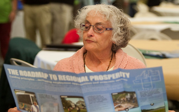 Record-Eagle/Douglas Tesner<br /> Elaine Case reads of the brochures before the start of the Grand Vision Citizen Action Expo Monday evening.