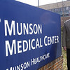 Record-Eagle/Douglas Tesner<br /> Tom McIntyre, chairman Munson Healthcare Board of Directors, said the only difference people will notice after Munson affiliates with Spectrum Health Systems is the Spectrum name in small print on Munson's signs.