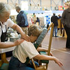 Record-Eagle/Jan-Michael Stump<br /> The Spa-a-ah owner Linda Wilson gives a hand and chair massage to Nancy Bier during  Wednesday's Leelanau Peninsula Chamber of Commerce Business Expo at the Strongheart Center in Peshawbestown.