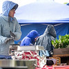 "Record-Eagle/Jan-Michael Stump<br /> Lori LaClair tries to stay warm over a small heater at her Natural Northern Foods stand on a cold, blustery Saturday at the Sara Hardy Downtown Farmers Market in Traverse City. ""It's little, but it takes the edge off,"" LaClair said."