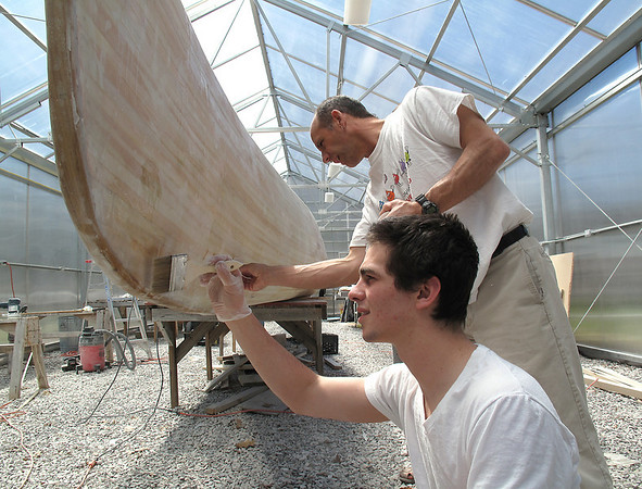 Record-Eagle/Lindsay VanHulle<br /> Max Williams, 18, a senior from the Cincinnati area, works with teacher Bruce Hood to seal a canoe students built at The Leelanau School in Glen Arbor. The boarding school works with high school students who have difficulty learning. The curriculum includes sensory and hands-on activities.