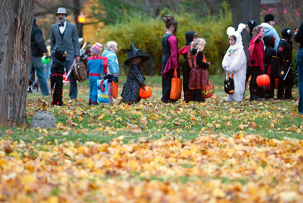 Record-Eagle/Jan-Michael Stump<br /> Trick or treaters pack Washington Street on Halloween.
