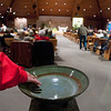 Record-Eagle/Jan-Michael Stump<br /> A parishoner dips her hand into an empty Holy Water Font before the start of Mass at St. Francis Catholic Churchin Traverse City.