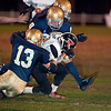 Record-Eagle/Jan-Michael Stump<br /> Rudyard running back Jared Clark (33) gets tackled by St. Francis defensive end Ian Sheldon (13) and linebacker Joey Kerridge (8) in the first quarter of Friday's game.