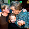 Record-Eagle/Jan-Michael Stump<br /> MaryAnn Moore hugs her daughter, Natalie Brown, and granddaughter Ally Brown, 9, after learning she won a seat on the Traverse City Commission.