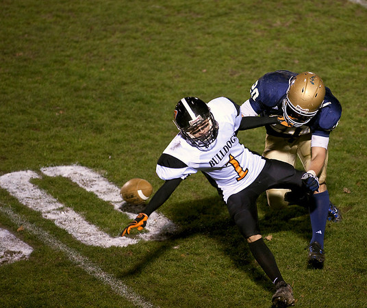 Record-Eagle/Jan-Michael Stump<br /> A Rudyard pass falls incomplete with St. Francis defensive back Matt Zakzrewski (20) covering in the third quarter of Friday's playoff game.