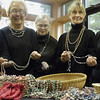 Record-Eagle/Lisa Perkins<br /> Members of the Unitarian Peacemaker Needleworkers group, from left, Pinkie Hoffmann, Marcia Bellinger, Joann Rosi, L.E. Smith and Kathy Prentice, inspect one-of-a-kind necklaces and bracelets, handmade by Ugandan women through the BeadforLife partnership. A sale of the jewelry will be held on Saturday at the Unitarian Universalist Congregation.