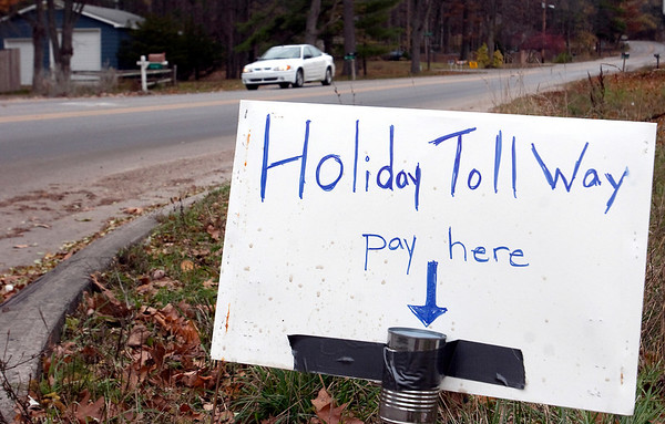 Record-Eagle/Douglas Tesner<br /> A sign on the corner of Five Mile and Holiday roads in Grand Traverse County expresses some residents' view of a possible road millage.