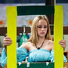 "Record-Eagle/Jan-Michael Stump<br /> Zoey Marsh adjusts her frame as she poses as Raphael's ""Lady With Unicorn,"" for a demonstration of Renaissance-era art at the Woodland School's annual history fair. Sixth-, seventh- and eighth-graders at the school held a Renaissance fair for younger students, all of whom have been studying various aspects of Renaissance life since the beginning of the school year. Several students reenacted paintings from the Pitti Palace in Florence, Italy, presenting information on a painting and its artist to their audience."
