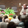 Record-Eagle/Jan-Michael Stump<br /> St. Francis Pastor, Fr. Ken Stachnik, reminds parishoners of precautions the church is taking to prevent the spread of H1N1 flu before the start of a recent Mass.