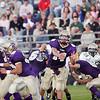 Record-Eagle file photo/Douglas Tesner<br /> Frankfort quarterback Dan Nugent throws passes vs. Muskegon Catholic.