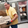 Record-Eagle/Jan-Michael Stump<br /> Tim Walker unpacks some of the 100 turkeys donated to the Father Fred Foundation by Northland Foods in Kalkaska Wednesday morning. The foundation will distribute 250 to 300 turkeys, along with some side items, to families for Thanksgiving.