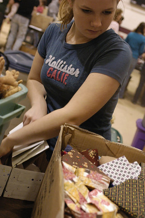 Record-Eagle/Lisa Perkins<br /> Mercy Kohler, 16, helps fill shoeboxes with donated presents for Operation Christmas Child. Kohler was one of 300 volunteers at a packing party held earlier this month at Traverse City Christian School. The boxes will be distributed to children in need in 100 countries around the globe.