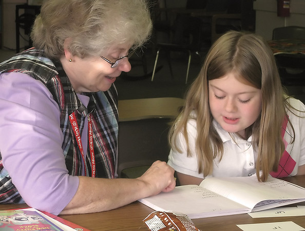 Record-Eagle/Jodee Taylor<br /> Betty Lape, left, spends time with Paige Phillips, 9, at Central Grade School's library.
