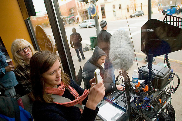 """Record-Eagle/Jan-Michael Stump<br /> Laura Crider, front, and Sue Jaquette, both of Traverse City, try to get a glimpse of actor Josh Lucas during filming for """"A Year in Mooring,"""" Sunday morning from inside Espresso Bay on East Front Street."""
