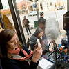 "Record-Eagle/Jan-Michael Stump<br /> Laura Crider, front, and Sue Jaquette, both of Traverse City, try to get a glimpse of actor Josh Lucas during filming for ""A Year in Mooring,"" Sunday morning from inside Espresso Bay on East Front Street."