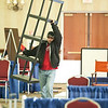 Record-Eagle/Jan-Michael Stump<br /> Mark Smith, of Trophy Trolley, carries in a shelving unit for the company's booth for today's Traverse City Area Chamber of Commerce Business Expo at the Grand Traverse Resort & Spa in Acme.