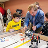 Record-Eagle/Douglas Tesner<br /> Coach John Failor, director of Sci-Ma-Tech at Traverse Central High School works with students as they work on their LEGO-based robots.