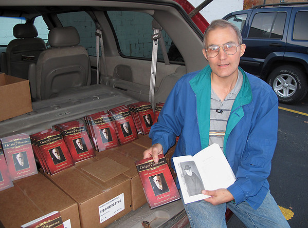 "Record-Eagle/Alex Piazza<br /> Bill Wiesner bought more than 250 special edition copies of Charles Darwin's ""Origin of Species."" He plans on passing them out today on Northwestern Michigan College's campus."