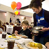 Record-Eagle file photo/Jan-Michael Stump<br /> Volunteer Maggie Mallery serves turkey dinners to, from left, Noah Hosler, 2, and Ian Cool, 5, and their grandmother Sue Peplinski during the 2008 Father Fred Thanksgiving Dinner at the Park Place Hotel. This year's event has been canceled.